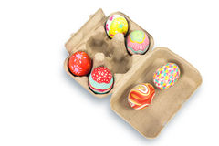 Colorful easter egg in pulp box on white background Stock Image