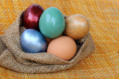 Colorful easter egg in sack bag Stock Photo