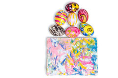 Colorful easter egg and small painted canvas on white Stock Images
