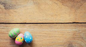 Colorful easter egg on wood background with space. Royalty Free Stock Photography