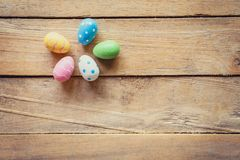 Colorful easter egg on wood background with space. Stock Images