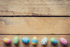 Colorful easter egg on wood background with space. Stock Image