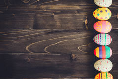 Colorful easter egg on wood background with space Stock Photos