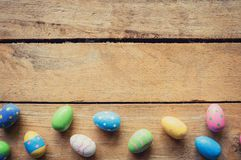 Colorful easter egg on wood background with space. Royalty Free Stock Images