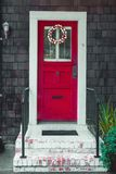 Colorful easter egg wreath on a front red door. A colorful easter egg wreath on a front red door stock images