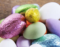 Colorful Easter Eggs. Colourful easter egg candy on a slate rock background Royalty Free Stock Image