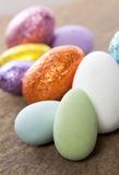 Colorful Easter Eggs. Colourful easter egg candy on a slate rock background Stock Photography