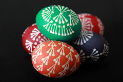Colorful Easter eggs. On the black table Stock Image