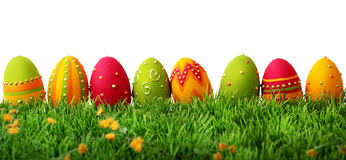 Colorful easter eggs. In a row on green grass Royalty Free Stock Images