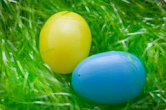 Colorful easter eggs. Two colorful plastic Easter eggs lying on green grass Stock Photo