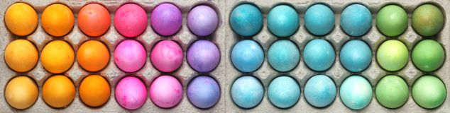 Colorful Easter eggs background. Cartons of colorful Easter eggs background Stock Image