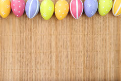 Colorful Easter eggs on bamboo background Stock Photography