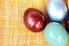 Colorful easter eggs on bamboo weave sheet background Stock Photo