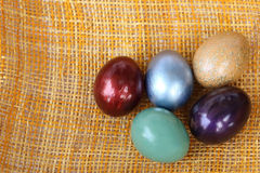 Colorful easter eggs on bamboo weave sheet background Royalty Free Stock Photography
