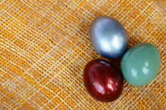 Colorful easter eggs on bamboo weave sheet background, Royalty Free Stock Image