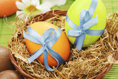 Colorful easter eggs in the basket Stock Images