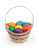 Colorful easter eggs in basket Royalty Free Stock Photo