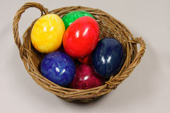 Colorful easter eggs. In a basket royalty free stock photos