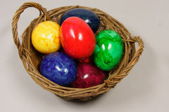 Colorful easter eggs. In a basket Stock Image