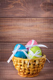 Colorful easter eggs in basket Stock Images