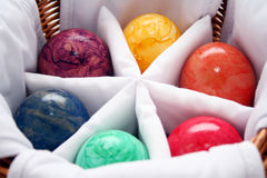 Colorful easter eggs in basket. A view of several colorful Easter eggs in a compartmented basket stock photo