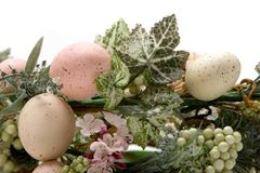 Colorful Easter eggs in a basket Stock Images