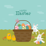 Colorful Easter Eggs in basket with bunnies and chicks. Royalty Free Stock Photography