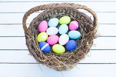 Colorful easter eggs in basket Stock Photo