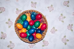 Colorful easter eggs in basket. Happy Easter, Christian religiou Royalty Free Stock Photo