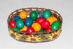 Colorful easter eggs in basket. Happy Easter, Christian religiou Stock Photography