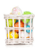 Colorful easter eggs basket Royalty Free Stock Photos