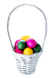 Colorful easter eggs in basket isolated on white background clos Stock Image