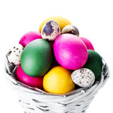 Colorful easter eggs in basket isolated on white Royalty Free Stock Image