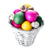 Colorful easter eggs in basket isolated on white background Royalty Free Stock Image