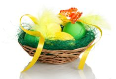 Colorful Easter eggs in basket isolated on white background. Colorful Easter eggs in a basket isolated on white background Stock Photo