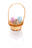 Colorful Easter eggs in the basket Royalty Free Stock Image