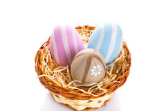 Colorful Easter eggs in the basket Stock Photography