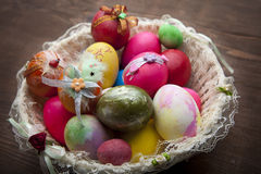 Colorful Easter eggs in the basket Stock Image