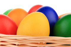 Colorful Easter eggs in basket. Royalty Free Stock Photos