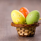Colorful Easter eggs in a basket Stock Image