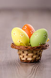 Colorful Easter eggs in a basket Stock Photography