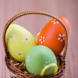 Colorful Easter eggs in a basket Stock Photos