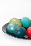 Colorful Easter eggs on the black plate Royalty Free Stock Photo