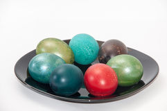 Colorful Easter eggs on the black plate Stock Photography