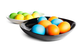 Colorful easter eggs on a black and white plates Stock Images