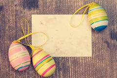 Colorful easter eggs and blank card Royalty Free Stock Images