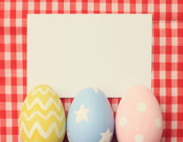 Colorful easter eggs and blank note paper Royalty Free Stock Photography