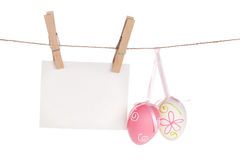 Colorful easter eggs and blank photo frame hanging on rope Stock Photography