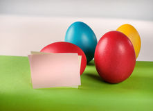 Colorful Easter eggs and blank post-its, paper notes. Stock Images