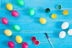 Colorful easter eggs on blue rustic wooden background Stock Photos